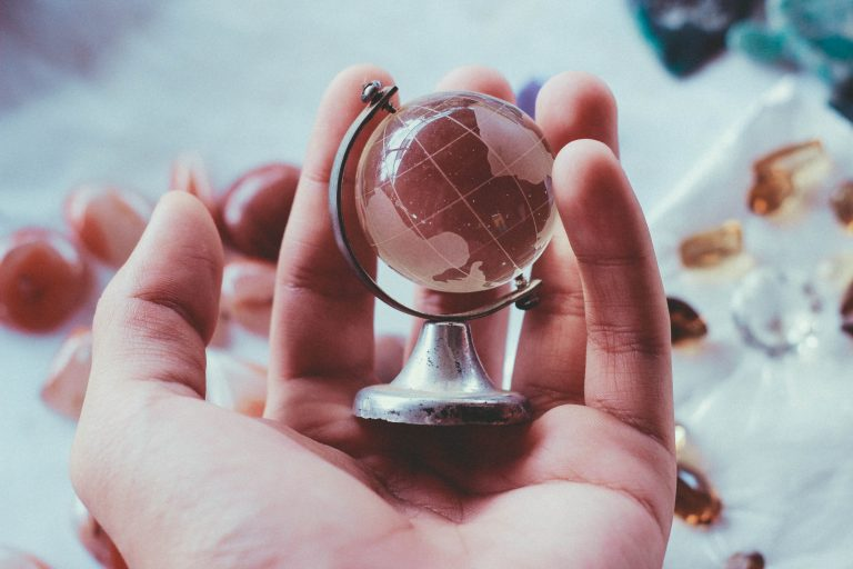 hand holding a miniture glass globe