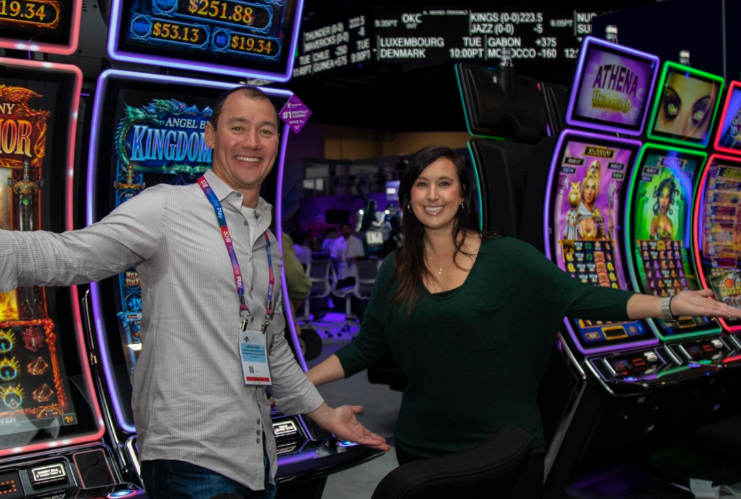two people infront of gaming machines
